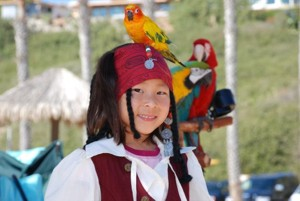 picture of girl with parrot on her head at parrots for parties