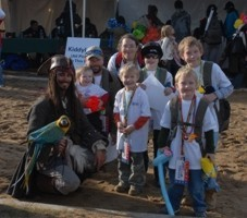 picture of a Captain Jack Sparrow impersonator with a parrot entertaining children at the Snowball Express 2007